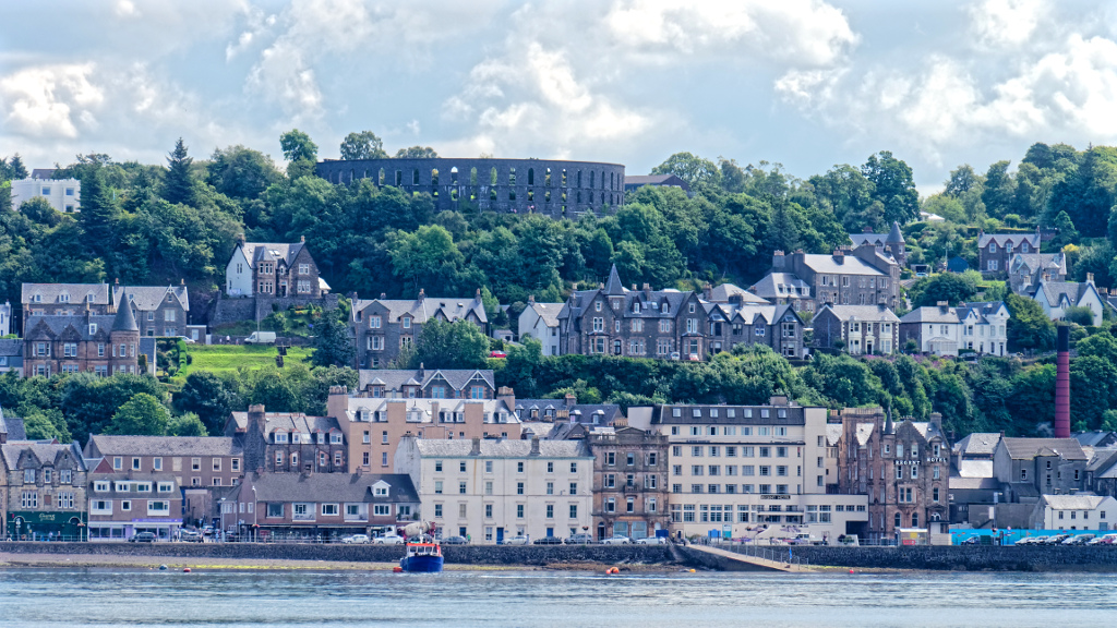 Oban town and McCaigs Tower looking from Kerrera